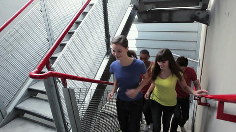 Young people running up stairs Stock Video Footage