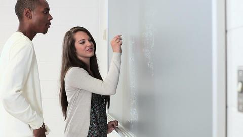 High school students using blackboard Stock Video Footage