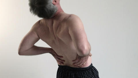 Man experiencing back pain Stock Video Footage