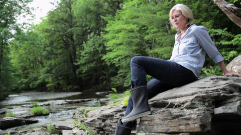 Mature woman in rural scene Stock Video Footage