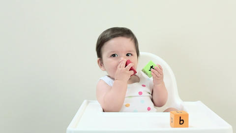 Baby boy playing with toy alphabet blocks Footage