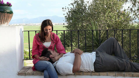 Young couple relaxing with man on woman's lap Stock Video Footage