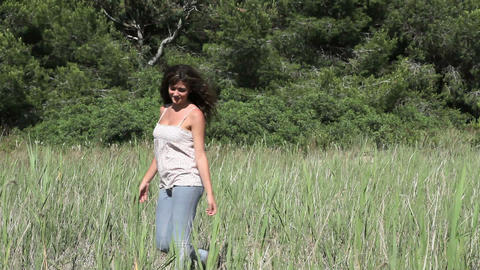 Young woman walking in field Stock Video Footage