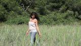 Young woman walking in field Footage