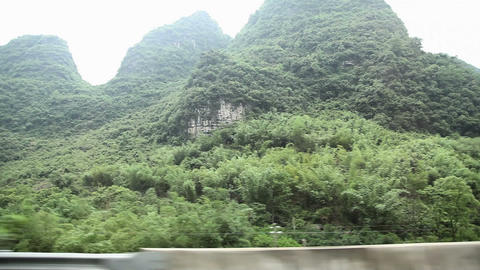 China, yangshuo, karst landscape viewed from moving... Stock Video Footage