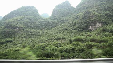 China, yangshuo, karst landscape viewed from moving transport Live Action