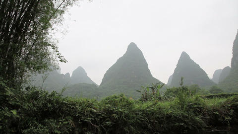 China, yangshuo, view of karst peaks from boat on yulong... Stock Video Footage