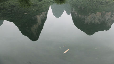 China, yangshuo, reflection of karst peaks in yulong river Live Action