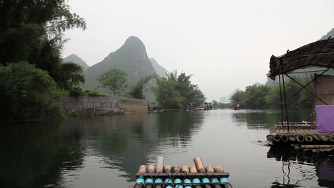 China, yangshuo, raft traveling on yulong river Stock Video Footage