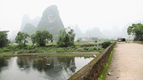 China, guangxi province,river and road in yangshuo Stock Video Footage