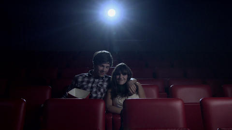 Young couple watching movie at the movie theater Live Action