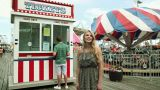 Teenage Girl Taking Boyfriend To Ticket Booth In Fun Fair stock footage