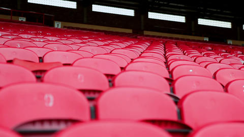 Red seats in empty stadium, tilt down Stock Video Footage