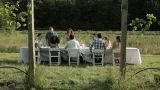 Young couple joining friends at farm dinner party Footage