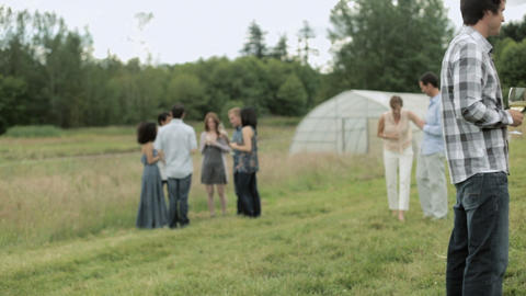 Chef preparing food and people socializing at farm dinner... Stock Video Footage