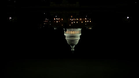 Reflection and united states capitol at night, tilt up Stock Video Footage