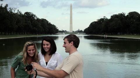 Friends taking photographs near washington monument Stock Video Footage