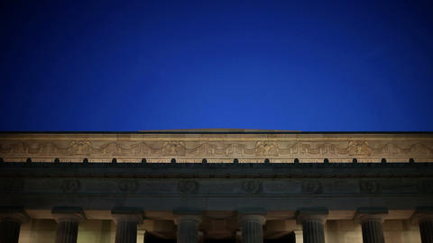 Lincoln memorial illuminated at night, tilt down Stock Video Footage