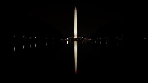 Washington monument and reflecting pool illuminated at night Stock Video Footage