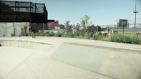Skateboarder on ramp at skatepark Stock Video Footage