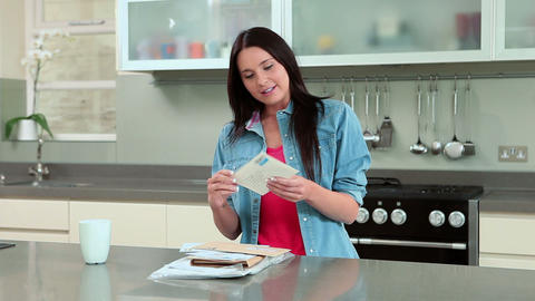 Young woman opening and reading letter Stock Video Footage