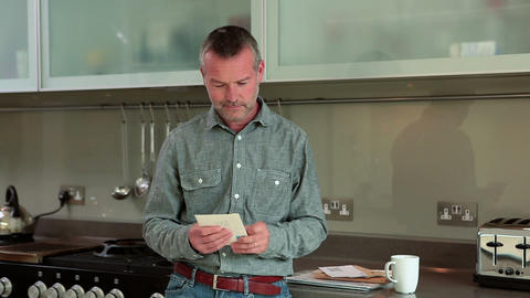 Mature man opening and reading letter Stock Video Footage