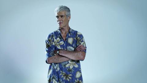 Senior man wearing hawaiian shirt with arms folded Stock Video Footage