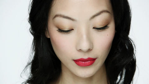 Young woman applying red lipstick Stock Video Footage