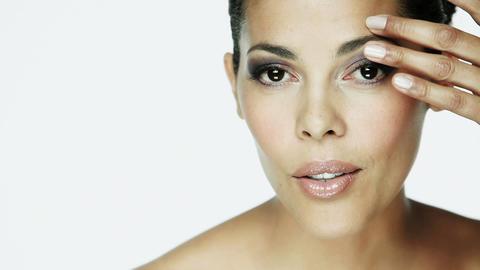 Woman using eyebrow comb Stock Video Footage