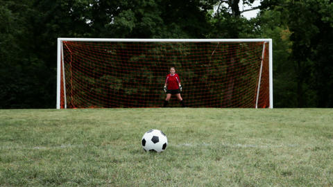 Soccer player hitting crossbar with ball Stock Video Footage