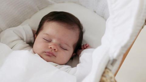 Baby girl sleeping in bassinet Stock Video Footage