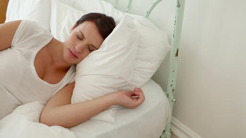 Pregnant woman sleeping on bed Stock Video Footage