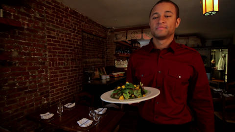 Waiter serving customer in restaurant Stock Video Footage