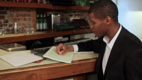 Restaurant owner looking at paperwork Stock Video Footage