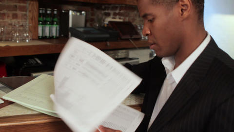 Restaurant owner looking at paperwork Stock Video Footage