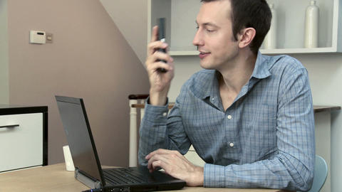Man booking insurance online, using phone Stock Video Footage