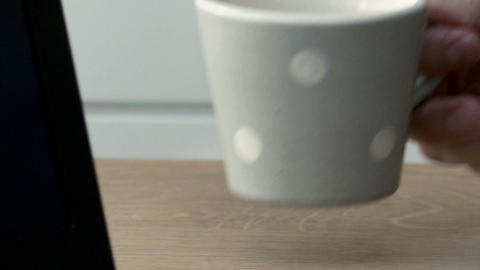 Laptop and cup of coffee, close up Stock Video Footage