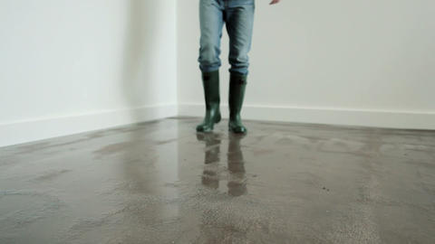 Young man standing on flooded floor on phone Stock Video Footage