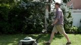 Man mowing grass with lawnmower Footage