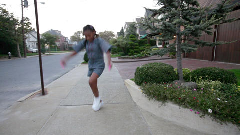 Girl skipping with rope on sidewalk Stock Video Footage