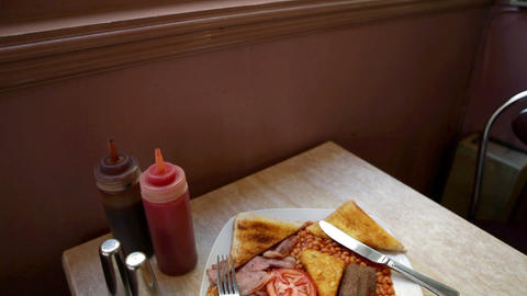 English breakfast on a cafe table Stock Video Footage