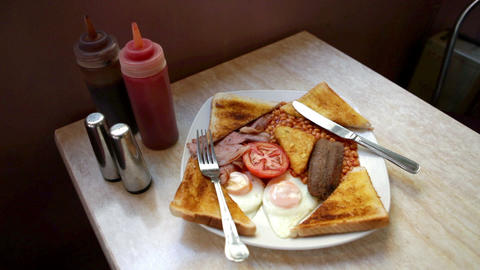 English breakfast on a cafe table Live Action