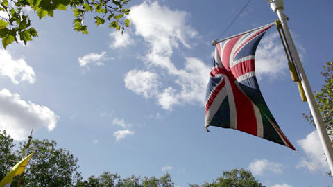 Low angle view of British flag blowing in breeze ビデオ