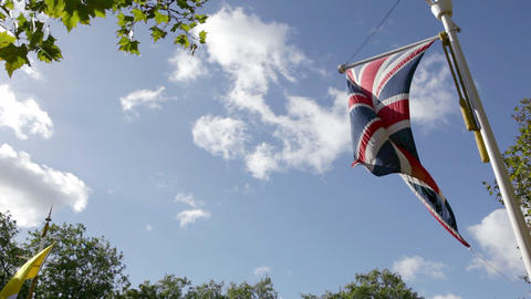 Low angle view of British flag blowing in breeze Stock Video Footage
