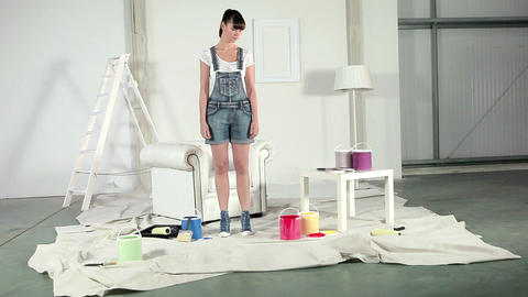 Young woman choosing red paint can Stock Video Footage