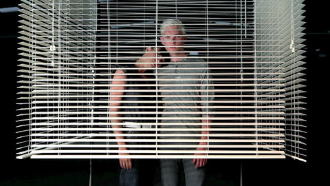 Young couple closing venetian blind Stock Video Footage