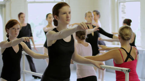 Girls doing ballet exercises at barre Stock Video Footage