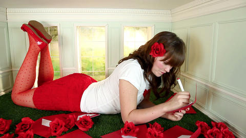 Young woman writing love letter in small room Stock Video Footage