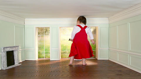 Giant toddler girl walking around in tiny room with key Stock Video Footage
