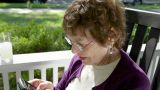 Senior woman on porch using smart phone Footage